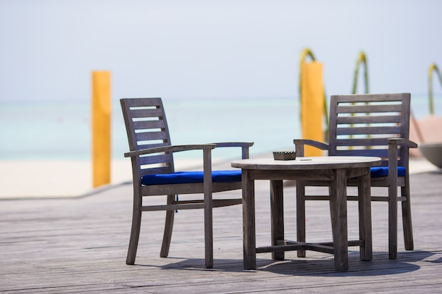 Summer empty outdoor cafe at exotic island in indian ocean
