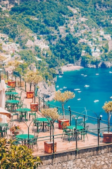 Summer empty outdoor cafe in a tourist place in italy