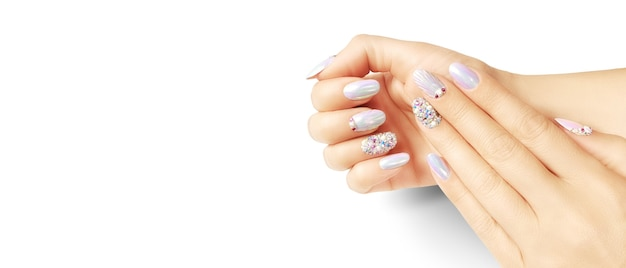 Summer fashion and beauty hand care concept with seashells