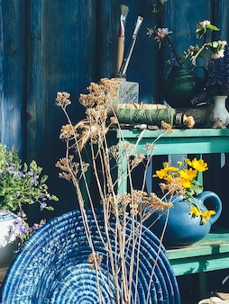 Summer floral composition blue color still life