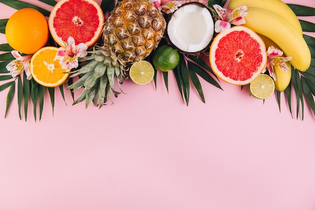 Summer fruit composition on pink table. flat lay, top view, copy space