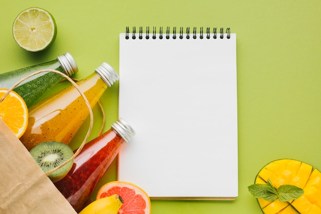 Summer fruit and juices with clipboard copyspace