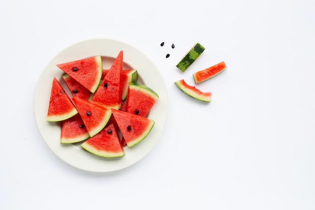 Summer fruit, slices of watermelon on white plate isolated on white