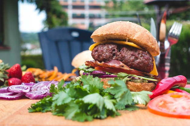 Summer garden barbecue colorful burger with organic ingredients