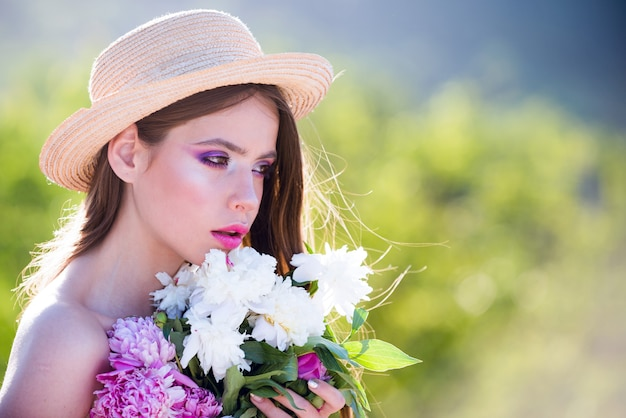 Summer girl with long hair. face and skincare. travel in summer. spring woman. springtime and vacation. natural beauty and spa therapy. woman with fashion makeup. a young woman at a flower farm.
