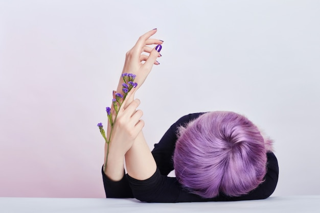 Summer girl with purple hair beautiful hands