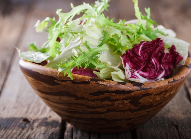 Summer green salad in a wooden bowl.