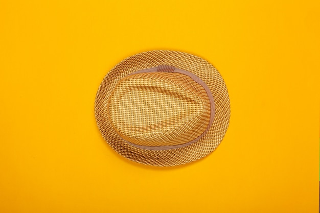 Summer hat on color. top view, flat lay