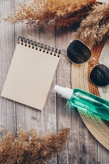 Summer hat glasses and suntan lotion summer and tourism concept