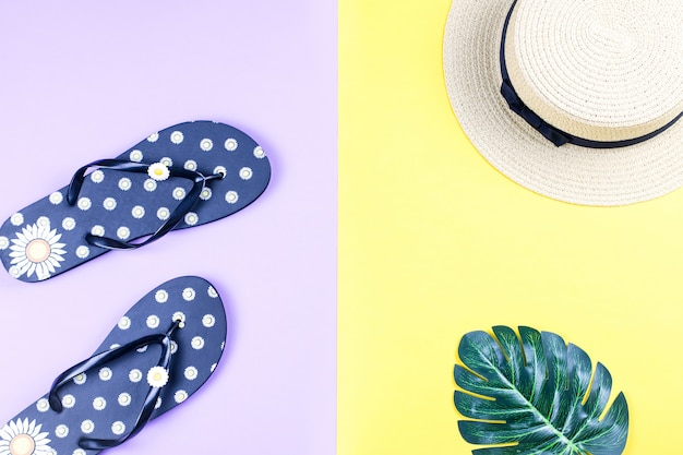 Summer holiday background. tropical summer concept with fashion accessories, leaves on bright background.