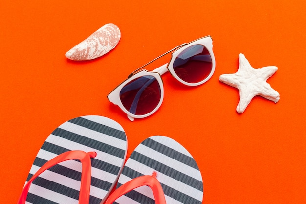 Summer holiday, beach accessories on color orange