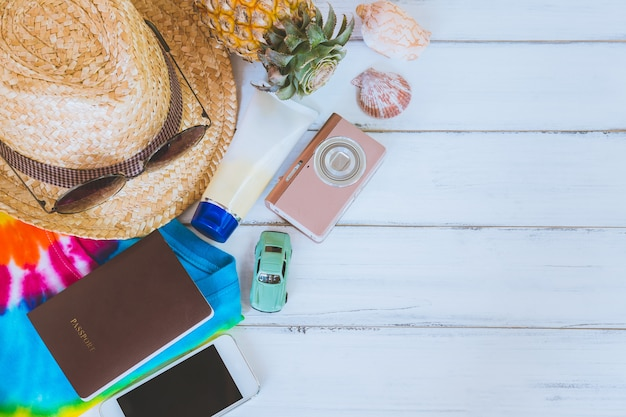 Summer holiday  ,beach accessories on white wooden and copy space