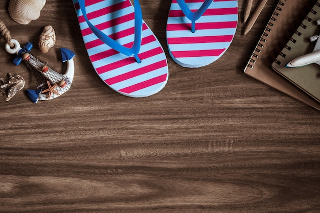 Summer holiday beach travel planning concept: top view of  sandals, and accessories