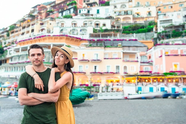 Summer holiday in italy. young couple in positano village on the background, amalfi coast, italy