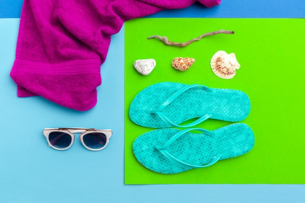 Summer holiday surface, beach accessories on color block surface