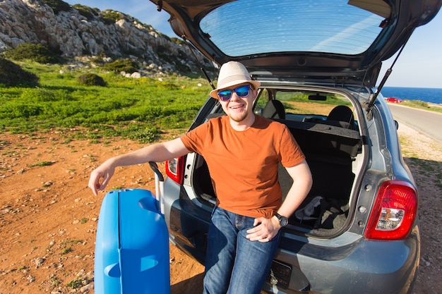 Summer, holiday, trip and vacation concept. man near the car ready to travel.