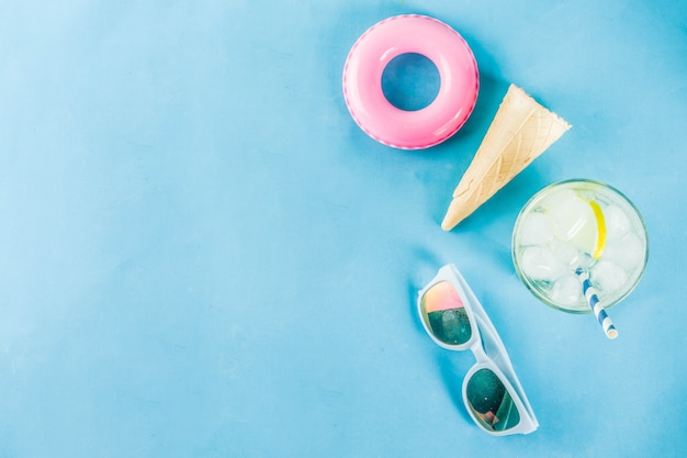 Summer holidays vacation concept background, hat, sunglasses, cooling drink  with ice, ice cream cones