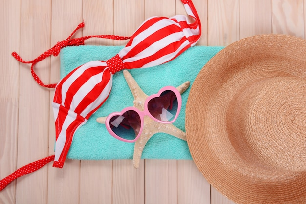 Summer items on wooden surface