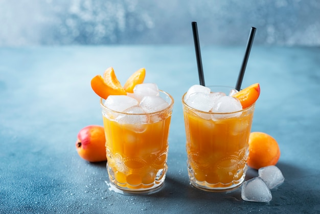 Summer juice with apricots and ice