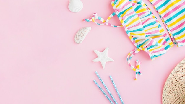 Summer marine items on pink background