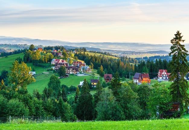 Summer morning hazy mountain village view  (gliczarow gorny, poland)