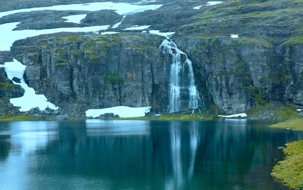 Summer mountain landscape with lake and waterfall (norway, aurlandsfjellet).
