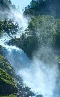 Summer mountain latefossen (or latefoss) waterfall on slope (odda, norway).