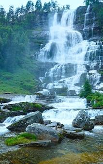 Summer mountain view of tvindefossen waterfalls (norway)
