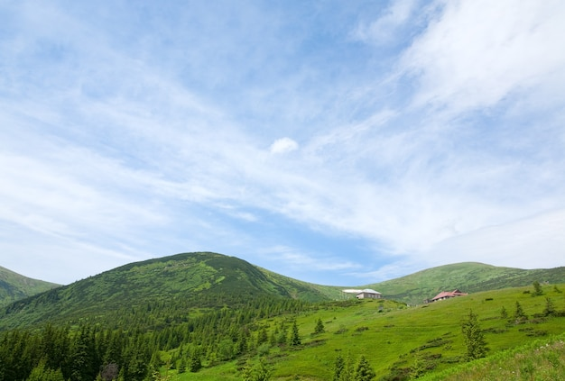Summer mountain view with some snow on mountainside (with weather and biological stations buildings on chornogora ridge, carpathian, ukraine)