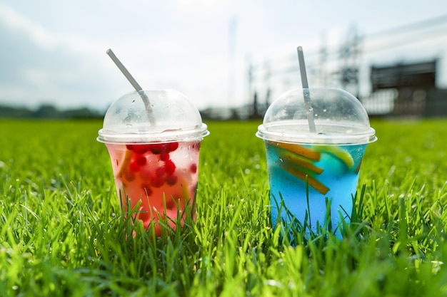 Summer natural refreshment drinks with ice, two glasses
