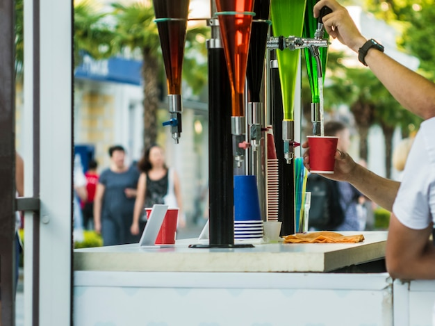 Summer open air bar faucet drinks in the city street party