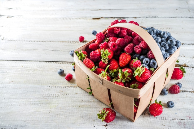 Summer organic farm berries in a basket