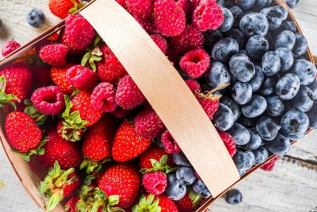Summer organic farm berries in a basket