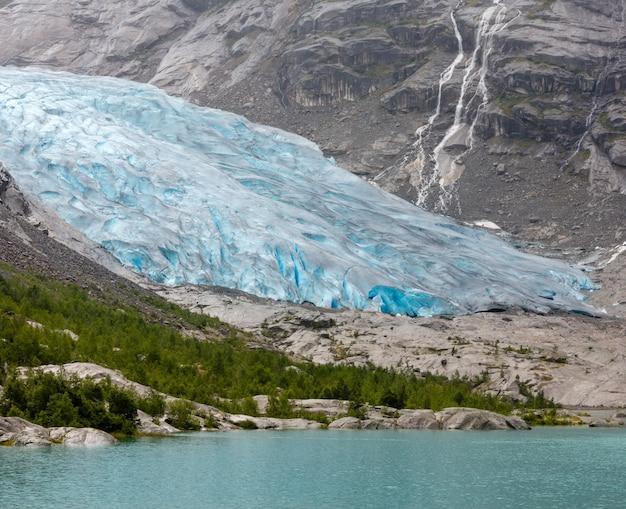 Summer overcast view to nigardsbreen glacier, jostedal, norway