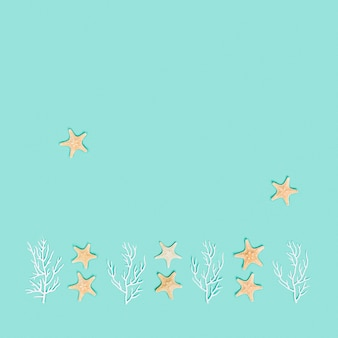 Summer pattern with star fishes and white coral marine or nautical themed flat lay top view
