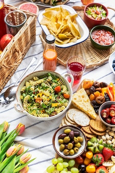 Summer picnic with pasta salad and snack board