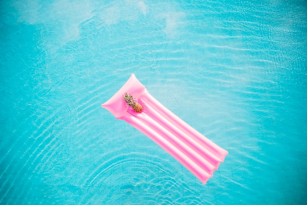 Summer and pool concept with inflatable mattress