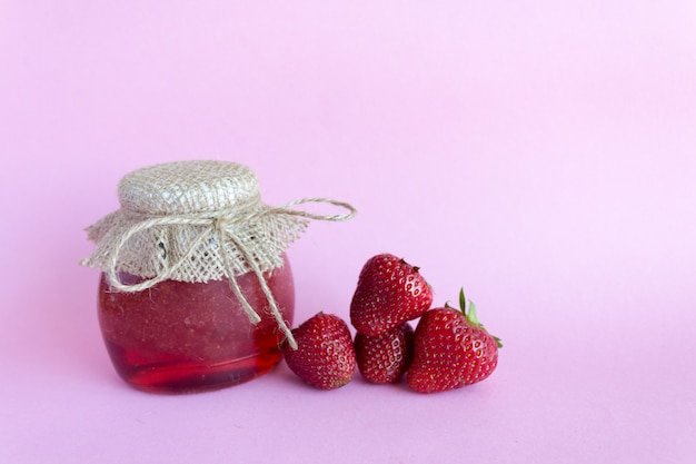 Summer preservation of jam. strawberry jam pink , strawberry berries