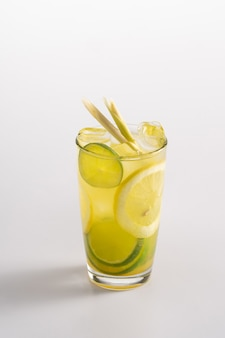 Summer refreshing cocktail with ice and alcohol. sparkling water, match syrup, mango syrup, lemon juice.