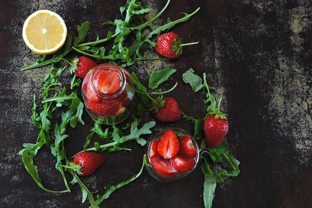Summer refreshing detox drink strawberry lemon arugula. keto drinks. keto diet.