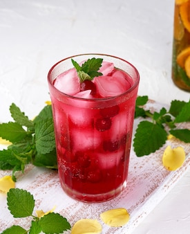 Summer refreshing drink with berries of cranberries