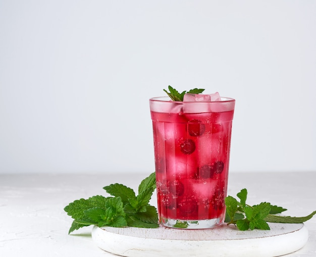Summer refreshing drink with red berries of cranberries