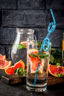 Summer refreshment detox water drink with pink grapefruit and fresh mint