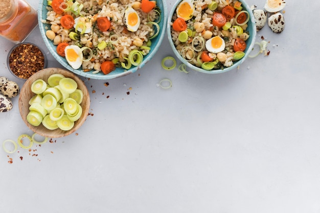 Summer salad with eggs and veggies copy space