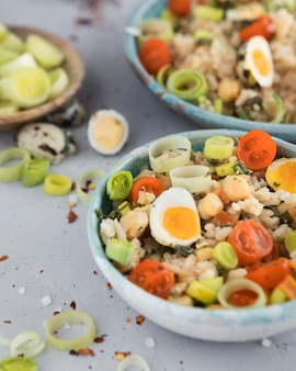 Summer salad with eggs and veggies high view