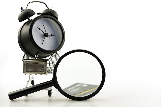Summer sale business objects of shopping cart with magnifying glass ,alarm clock and credit card copy space for your text.