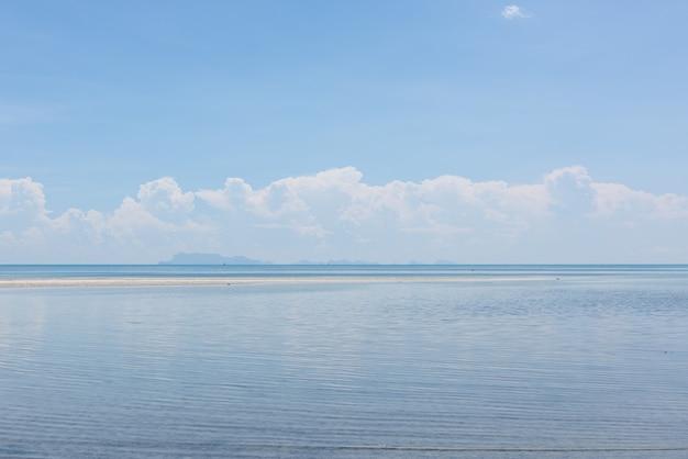 Summer seascape bright blue sea sky white clouds background