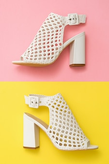 Summer shoes made of white leather on yellow and pink