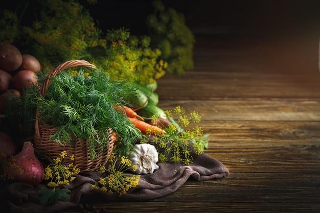 Summer still life of ripe vegetables and dill.