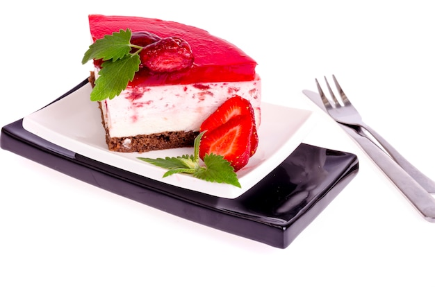Summer strawberry mousse cake with fresh berries on white background.